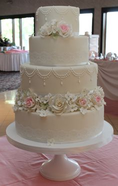Four tier wedding cake from this weekend, it was a biggie too...16, 13, 11, 7.  Finished with lace and lots of sugar flowers.  Design credit to Tracey James of Cotton & Crumbs.