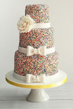 wedding cake covered in sprinkles
