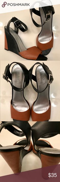 Tildon Brown/Black Leather Wedge Sandals Tildon burnt orange with black contrast leather  wedge Sandal is versatile & comfy. Work, play or weekend ready. Small wear on leather (inside foot) from storage of shoes. Only worn once. Size 10. Buckle adjustable ankle strap. Tildon Shoes Wedges