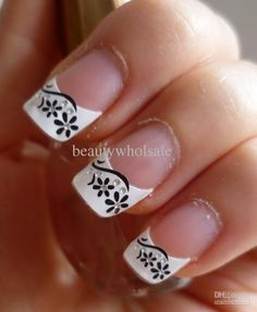 Nail art. White tips with black flowers. Very pretty!