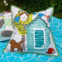 Coordinating cushion for Potting Shed design duvet set.