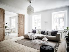 scandi living room with timber double doors  | stadshem