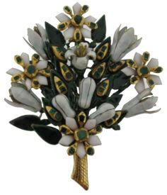 A late 17th Century floral brooch. Mounted with open and closed flower heads. Set with emeralds and decorated overall in green black and white enamel. Mounted in gold. 7.5cm high.