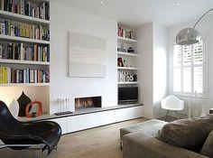 built-in shelves flanking a modern fireplace