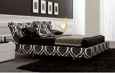 Upholstered boxspring and headboard instead of bed skirt. Good idea for Chelsea's apartment.