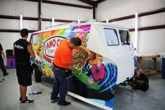 "Another totally tubular design was created for this 1961 Ford Econoline van. The client wanted to go in a direction that was ""hippy"" but at the same time wanted to maintain a surfer theme. In order to satisfy both cravings, the artist pulled bright colors you generally see in the hippy art and married it to the surf-themed imagery."
