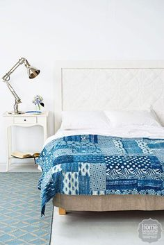 Pressed-tin tiles painted white make for a subtle and stylish #DIY headboard.