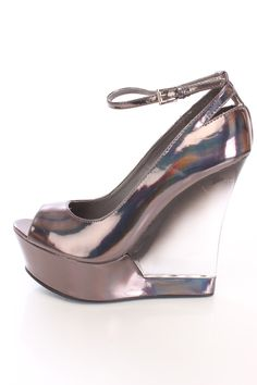 You will be head over heels for these saucy little numbers! They will perfectly compliment any outfit for any occasion! Make sure to add these to your collection, they definitely are a must have! The features for these wedges include a faux leather upper with a holographic finish, peep toe, scoop vamp, ankle strap with a side buckle closure, translucent wedge inset, smooth lining, and cushioned footbed. Approximately 5 1/2 inch wedge heels and 2 inch platforms.