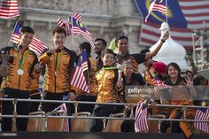 Members of the Malaysian olympic team interact with the public during the parade held for the national day marking 59 years from Malaysia's independence at the Independence Square in Kuala Lumpur, Malaysia on August 31, 2016.
