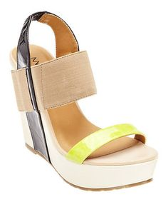 Strut in style with this sleek and savvy sandal. In addition to its wide and stretchy straps, pops of color captivate the eye to complement any fashion-forward ensemble.