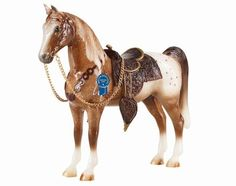 Breyer Vintage Western Pony Traditional Style Model Horse Toy - First introduced in the 1950's, this beautiful spotted chestnut roan stands tall and proud, awaiting his next adventure! Sculpted by Chris Hess, the Western Pony was one of the first Breyer models to be created!