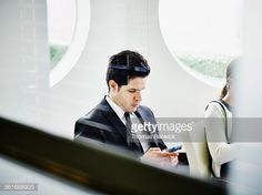 Stock Photo : Businessman checking information on smartphone