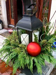 Winter containers using a lantern as the centerpiece. Don't forget you can garden in the winter too! Home decor, porch decor, bring some color to the winter. #Centerpieces #Christmas