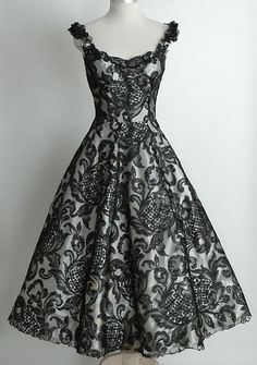 Wow - beautiful black lace dress in a classic and flattering cut. Want!