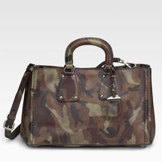 """Prada Saffiano Camouflage Camo print Tote bag Prada multicolor Saffiano Camo print Tote, 100% guaranteed authentic.  Retail $2200.  In excellent condition, inside is a little dirty from use, but there are no other flaws.  Saffiano calfskin leather in a camouflage print with hand-stitched details. Double top handles 3"""" drop, adjustable detachable shoulder strap 10""""-15"""" drop, top snap closure, stitching details, protective metal feet one inside zip pocket two inside cell phone pockets fully…"""