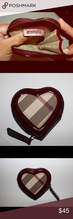 Burberry Zip Around Heart Shaped Coin Purse Charming heart-shaped coin purse is outlined in glossy patent and patterned in checks. Zip-around closure. PVC with leather trim. Excellent pre-loved condition. Light signs of wear inside from coins. Burberry Bags Wallets