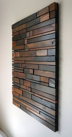 This piece is made to order. Lead time for shipping is 4 to 6 weeks .  The photo shown is a previously sold beautiful modern art piece made with reclaimed wood. We have finished each piece of wood by hand then used 4 different shades of stain. These natural colors keep the rustic look of the wood by bringing out the grain while also giving it a modern touch by the way the pieces are placed together. This would look great hanging vertically in a bedroom, above a couch in a living room or…