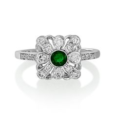 Art Deco Ring for sale in Glasgow, Edinburgh & Scotland. The roaring twenties inaugurated the Art Deco design period. Discrete Understated a perfect addition to your jewellery collection. These days it is difficult to acquire original pieces from that period in  good condition. Here we have re created your favorite style. An emerald and diamond deco style ring all mounted in 18ct white gold.1/3 of a carat of diamonds and .20ct emerald. Mouth watering I'm sure you will agree!
