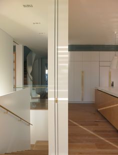 Love the way they have used brass finishes throughout home, flows beautifully.  PohioAdams Architects
