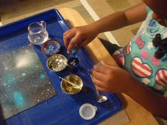 Children make their Universe in a jar. From The Work Plan: My Universe