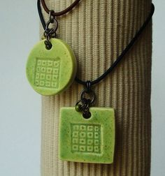 Artgirl56: His and Hers Jewelry, clay pendants, porcelain, Mod Pistachio, streamlined design, men and women, gift, accessories. $24.50, via Etsy.