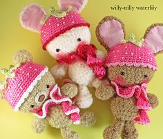 so cute I can hardly stand it! crocheted furries with strawberry caps