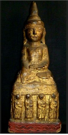 Late 18thc Burmese Carved wood and lacquer Buddha finished in gold leaf.