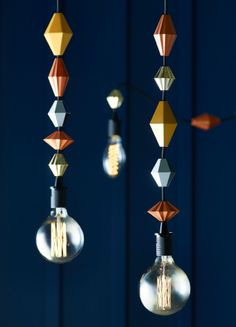 Lamp cords with copper-coloured geometric plastic beads.