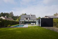 A typical Belgian farmhouse, known as a 'fernette' inspires this addition to a residence, House DS, with an expansive back garden in Destelbergen, Belgium. Architects Graux & Baeyens addressed the client's request of ensuring the addition would provide 'spacious, bright and contemporary living' and molded the idea of 4 rectilinear volumes as extensions of the existing building, creating a stark contrast between old and new, past and present. A fifth volume in the form of a pool house also…