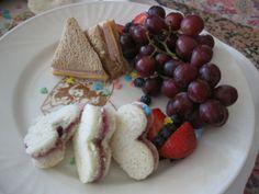 Heart-shaped finger sandwiches and decorative cocoa stencils