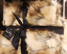 7714d901432a This faur fur throw from  HomeGoods is equal parts lush and luxe.  TheGifter