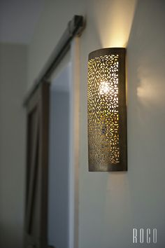 laser cut metal light fixture. the majority of the light is projected upwards with a small amount escaping through the small open design.
