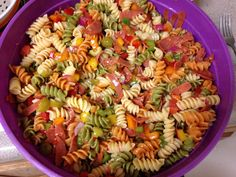Pasta salad: green, red, yellow, and green peppers, cucumber, tomatoes, turkey pepperoni, green olives, rainbow rotini  noodles(2lbs), purple onion (1/4 c). Zesty Italian dressing (2-3) depending on your taste. Cut up the veggies and pepperoni to a bite size, Cook pasta, then drain and put in with the veggies, add Italian, Mix well., refrigerate overnight. Stir before serving