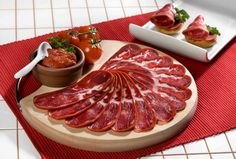 Pastirma, dried aged beef, and the most famous being that is produced in the town of Kayseri in central Turkey. The term literally means 'being pressed in Turkish and is the origin of the Italian pastrami.   http://marketurk.co.uk/en/grocery/63/pastirma #Turkish food #Kayseri pastirma #Traditional Turkish food #