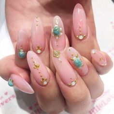 Pastel pink nails with gold and turquoise decals