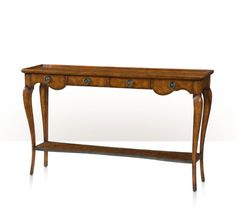 An oak parquetry console table, the dished top above four frieze drawers, on cabriole legs joined by an undertier. The original Louis XV.