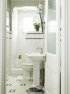 half wall shower for downstairs- love that black& white.England House Plans Blog | Home Design Information and Ideas