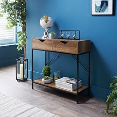 A stylish new addition to your home, perfect for your living room. A contemporary Console Table with a black metal frame, with wooden drawers and shelf.