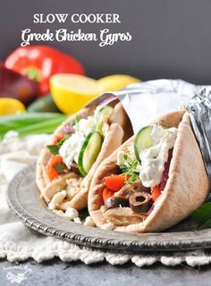 Loaded with plenty of fresh herbs, garlic, and Mediterranean flavor, these Slow Cooker Greek Chicken Gyros are a healthy 10-minute dinner!