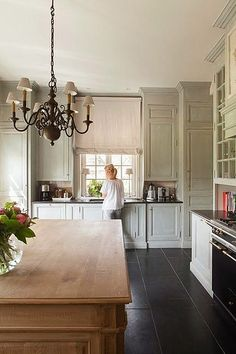 Gray and neutral kitchen by Things That Inspire, via Flickr - love the matte grey finish, natural on the island