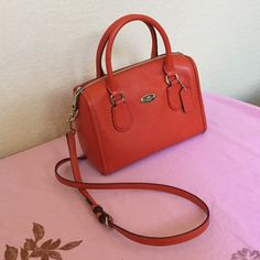 Coach mini crossbody satchel That beautiful pop of orange color. Used but cared for, has a bit of black scruff from pants on one corner. (As seen in photo).  Mint condition. Match it with your summer dresses or outfits. Coach Bags Mini Bags