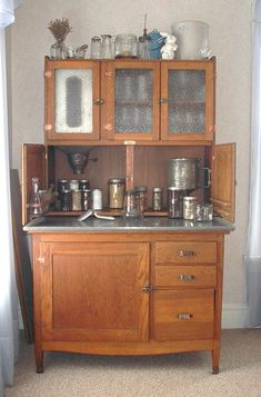I want a Hoosier Cabinet so badly!  On my list of antique/decor items to get! (MG)