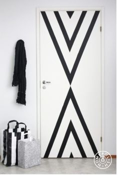 Add drama to your doors with tape and paint.
