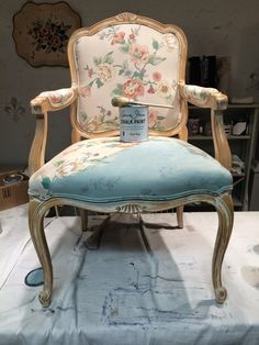 Looks like a Duck Egg Blue chair with leather upholstery   and a bit of gilding on the same tone frame.   But it didn't always loo...