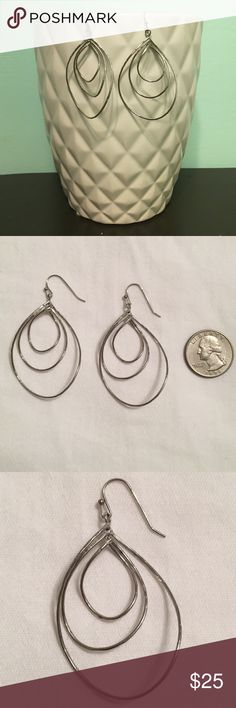 Silver Swirl Earrings Lovely silver earrings that swirl and rotate as you move. Make an offer! 15% off bundles of 2 or more items. Jewelry Earrings