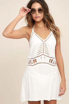Pack the Exotic Locale White Crocheted Cover-Up for wherever your travels take you! Gauzy woven fabric flows from crisscrossing adjustable straps into a triangle bodice with pierced embroidery throughout. Relaxed silhouette ends in a leg barring length. As Seen On Emily of @emilyrosehannon!
