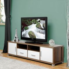 @Overstock - A striking, contemporary blend of white and light wood grain makes a trendy statement for any room of your home. This television cabinet features a rich walnut wood finish that will complement any home's decor.http://www.overstock.com/Home-Garden/Carmen-TV-Cabinet/6084470/product.html?CID=214117 $285.99