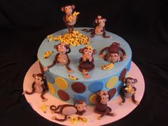 Monkeys with their banana's - This cake was a fun cake to make. I made the monkey's and the banana's from fondant. It's covered in buttercream.