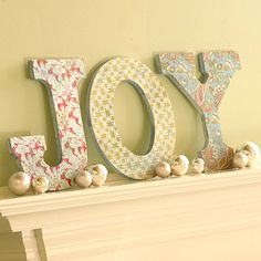 Do with fun word for springtime!  (Turn your mantel into a holiday greeting. Trace large wooden letters onto scrapbooking paper. Cut out the shapes and use decoupage medium to adhere the papers to the wooden letters. For a bit of sparkle, apply another thin coat of decoupage medium to the letters and sprinkle with glitter.)