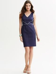 This dress with white cardigan and white peep toe pumps  Piped v-neck sheath | Banana Republic